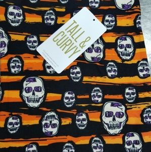 LULAROE LEGGINGS TC SKULLS ORANGE AND BLACK